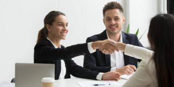 hr-representatives-positively-greeting-female-job-candidate_1163-4702
